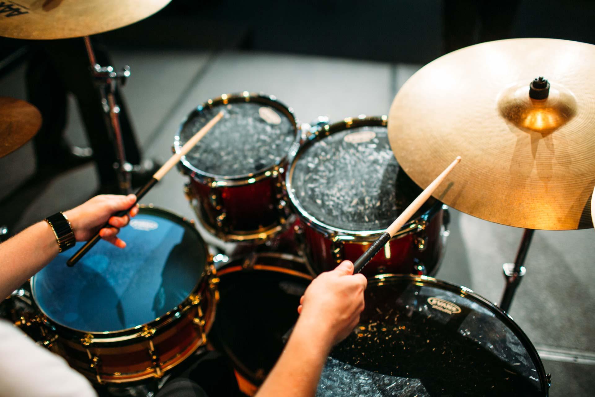 Drum teacher Ash Carnie teaching the drums in Brisbane